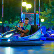 Father and son having fun, driving electric toy car — Stock Photo