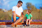 Father and son talking, summer outdoor — Stock Photo