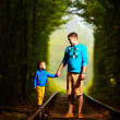 Stock Photo: Father and son together in railway green tonel