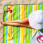 Seductive woman taking sunbathe on beach — Stock Photo #31602163
