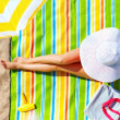 Seductive woman taking sunbathe on beach — Stock Photo