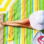 Seductive woman taking sunbathe on beach — Stock Photo #31602187
