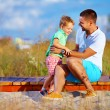 Father and son having fun playing at summer field — Stock Photo