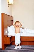 Happy kid enjoying hotel room after bathing — Stock Photo