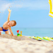Active kid playing in sand on the beach — Stock Photo