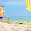 Active kid playing in sand on the beach — Stock Photo #32352985