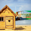 Cute children playhouse near lake — Stock Photo #32723265