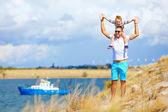 Happy father and son enjoying seaside landscape — Stock Photo