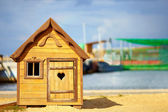 Cute children playhouse near the lake — Stock Photo