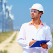 Stock Photo: Researcher analyzes readouts on wind power station