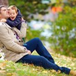 Happy father and son having fun in autumn park — Stock Photo #33929745