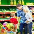 Stock Photo: Candid portrait of family buying food in supermarket