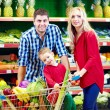 Stock Photo: Family shopping in grocery market