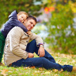 Happy father and son having fun in autumn park — Stock Photo