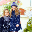 Winter portrait of happy mother and daughter — Stok fotoğraf