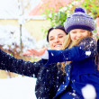 Winter fun. happy family playing with snowballs — Stock Photo