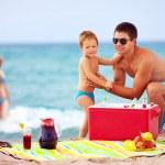 Happy family on summer beach picnic — Stock Photo #35136925