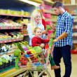 Family shopping in grocery supermarket — Stock Photo #35137083