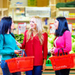 Stock Photo: Beautiful girls shopping in grocery supermarket