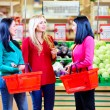 Beautiful girls shopping in grocery supermarket — Stock Photo