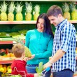 Family shopping in supermarket — Stock Photo #35370399
