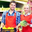 Smiling grocery staff working in supermarket — Stock Photo #35370425