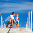 Happy father and son playing on blue sky horizon — Stock Photo