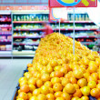 Rows of citrus fruits in supermarket — Stock Photo