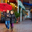 Happy kids running the street under the rain — Stock Photo