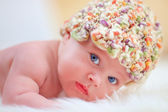 Portrait of cute little baby in colorful hat — Stock Photo