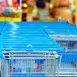 Stock Photo: Rows of supermarket shopping cart trolleys
