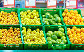 Rows of fresh citrus fruits in mall — Stock Photo
