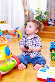 Cute toddler baby playing with toys — Stock Photo