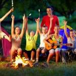 Laughing kids friends having fun around campfire — Stock Photo #39964503