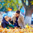 Laughing family having fun in autumn park — Stock Photo