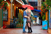 Couple in love kissing under the rain — Stock Photo