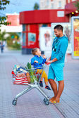 Happy father and son after shopping in supermarket — Stock Photo