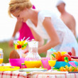 Stock Photo: Preparing picnic table in summer park