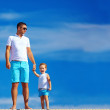 Stock Photo: Father and son on sky background
