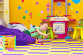 Excited kid having fun in kindergarten — Stock Photo