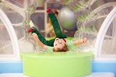 Excited kid having fun on playground — Stock Photo