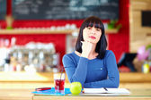 Beautiful girl student in cafe — Stock Photo
