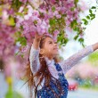 Beautiful girl enjoying life in spring garden — Stock Photo