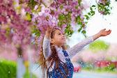 Beautiful girl enjoying life in spring garden — Stock Photo
