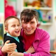 Cheerful kids with disabilities in rehabilitation center — Stock Photo #44263601