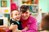 Cheerful kids with disabilities in rehabilitation center — Stock Photo