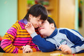 Relations between kids with disabilities — Stock Photo