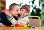 Happy kids with disabilities in preschool — Stock Photo
