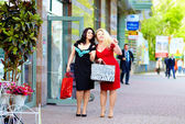 Happy plus size women shopping — Stock Photo