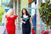 Happy plus size women shopping — Stock Photo
